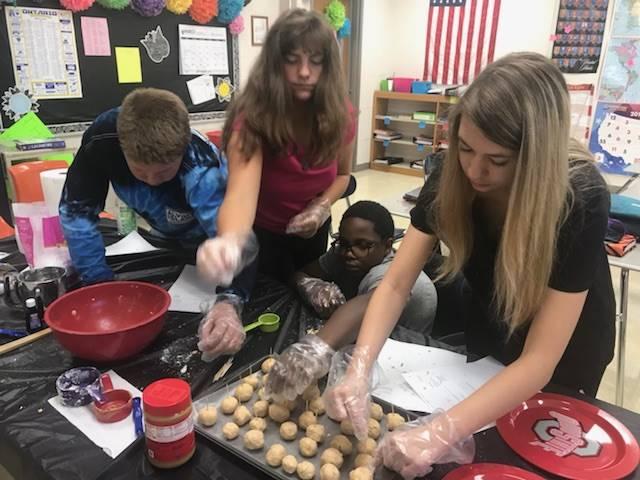 students mold dough