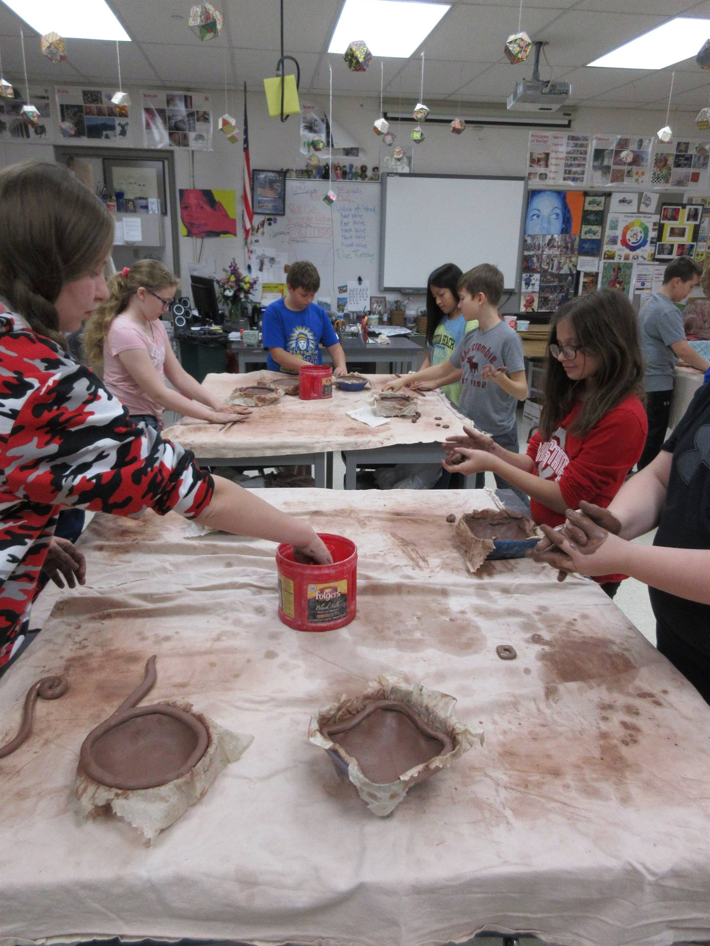 students with clay