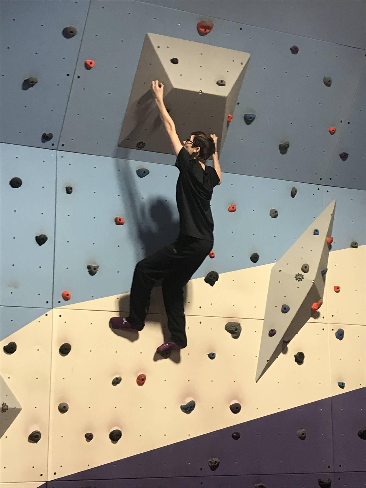 boy climbing wall