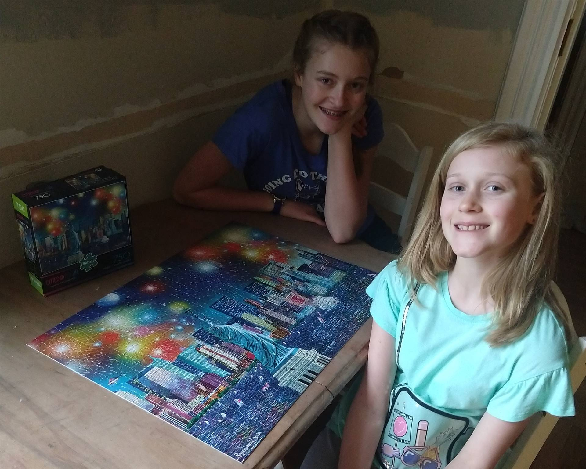 sisters with puzzle